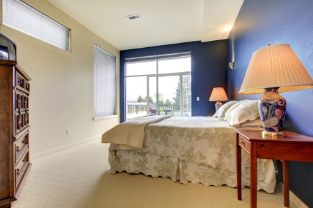 Bedroom interior with blue wall and asian lamps. Stock Photo - 17647094