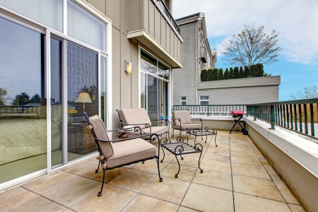 apartment: Balcony, large terrace with furniture in new apartment building. Stock Photo