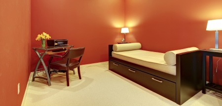 furnished apartments: Red room with sofa bed and office desk with printer