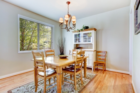 dining table and chairs: Natural grey dining room interior with wood table and cabinet.  Stock Photo
