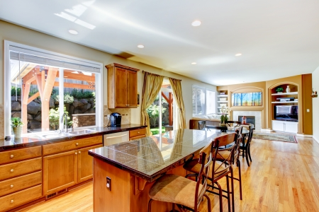 wood ceiling: Wood classic large kitchen with granite island.
