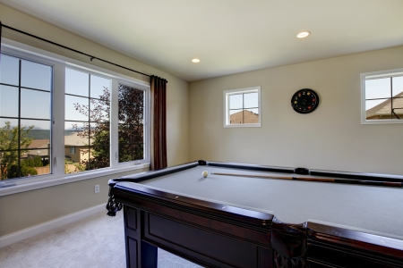 Large family room with pool table, sofa  and tv. photo