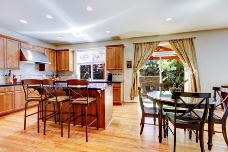 furnished apartments: Wood classic large kitchen with granite island.