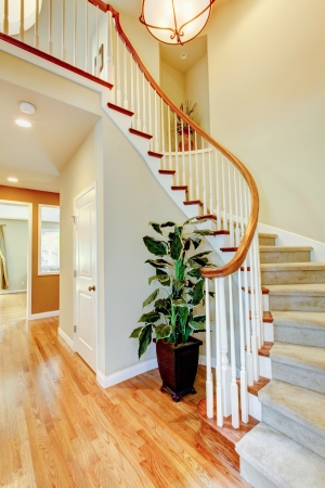 Curved staircase with hallway and hardwood floor. Home interior. Stock Photo - 17749802