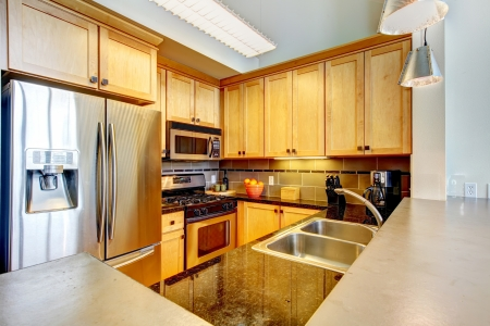 furnished apartments: Modern apartment wood kitchen interior with large countertop  Stock Photo