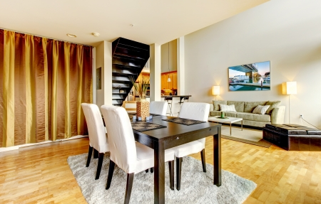 DIning room interior in modern city apartment with high loft ceiling