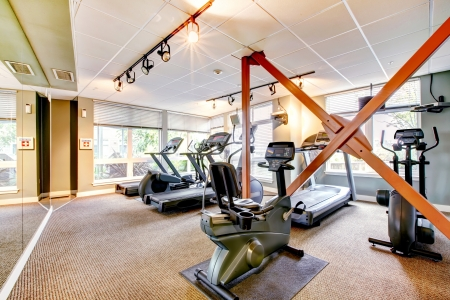Gym in apartment building with mirror  photo