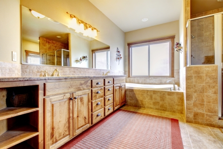 Large bathroom with wood furniture and natural colors. Stock Photo - 17848874