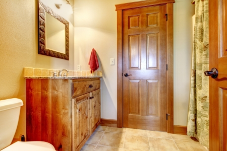 Large bathroom with wood furniture and natural colors. Stock Photo - 17848880