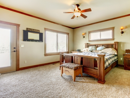 Natural cabin farm house bedroom with beige carpet and green walls. Stock Photo - 17848881