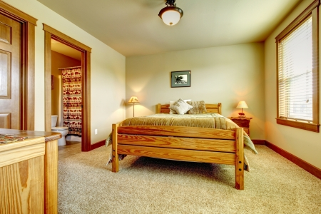 Natural cabin farm house bedroom with beige carpet and green walls. Stock Photo - 17848852