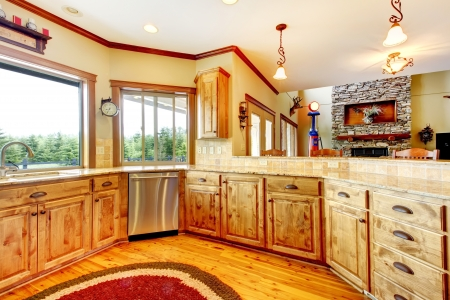 home appliances: Wood luxury home kitchen interior. New Farm American home. Stock Photo