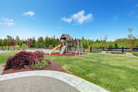Large luxury home back yard with play ground for kids. Stock Photo - 17848841