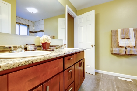 New bathroom interior with cherry sink cabinet ad white tub  Stock Photo