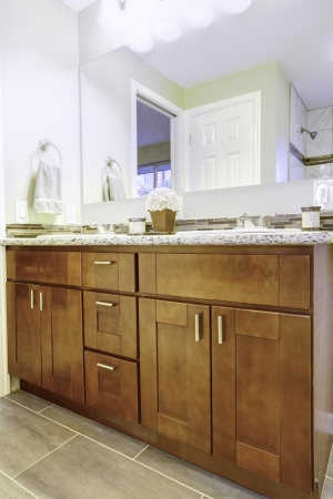 New bathroom interior with cherry sink cabinet ad white tub Stock Photo - 17869726