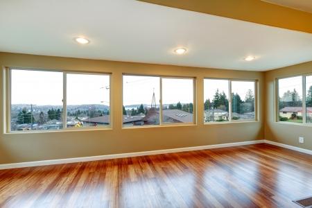 many windows: Room interior with many windows and hardwood floor