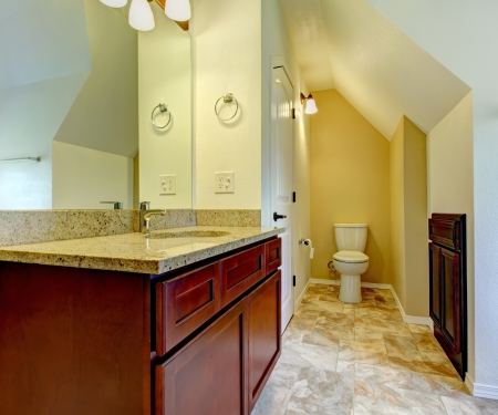 New empty bathroom with wood cabinets and toilet. Simple interior. Stock Photo - 17869738