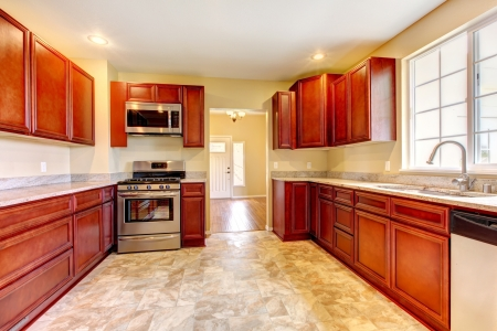 New cherry wood kitchen with stinless steal appliances. Stock Photo - 17869765