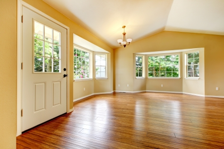 hardwood: Large empty newly remodeled living room with wood floor.
