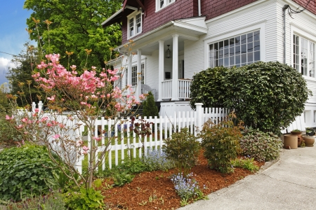 Classic large craftsman old American house exterior in red and white during spring. Stock Photo - 18174485