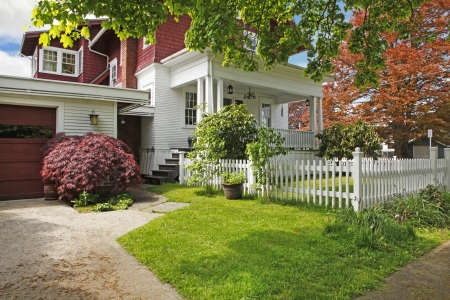 Classic large craftsman old American house exterior in red and white during spring. Stock Photo - 18174486
