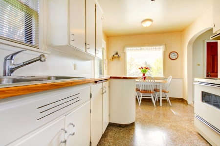 build in: White old small kitchen interior in American house build in 1942.