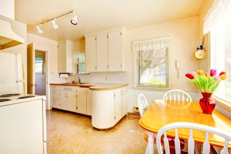White old small kitchen interior in American house build in 1942. Stock Photo - 18174363