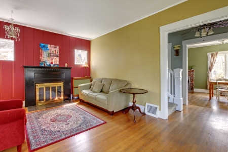 Living room with red and yellow walls and fireplace in old American house  photo