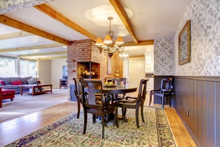 wood molding: Dining room near brick fireplace and living room. Open floor plan.