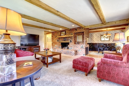 Living room interior with brick fireplace, wood beams and red. Stock Photo - 18230674