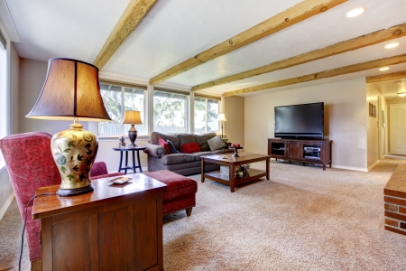 Living room inter with brick fireplace, wood beams and red. Stock Photo - 18230670