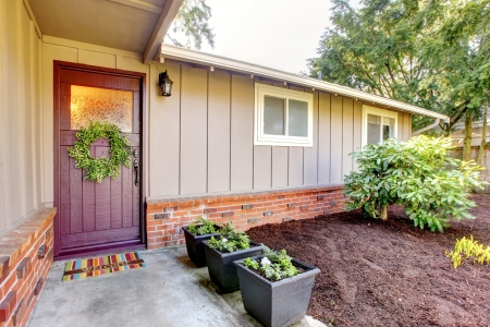 Brown grey house exterior with front door and spring landscape. Stock Photo - 18230673