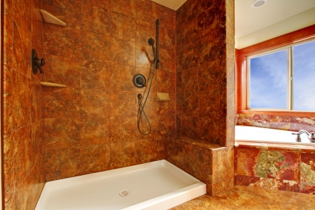 corner tub: Luxury red marble bathroom  with shower in a New luxury home interior.