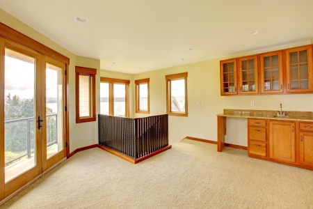 Empty large room with wood cabinets. New luxury home interior. Stock Photo - 18283835