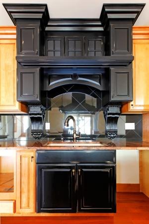 Kitchen island and stove custom wood cabinets. New luxury home interior. Stock Photo - 18283809