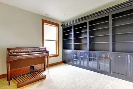 home office interior: Empty library office room with piano. New luxury home interior.
