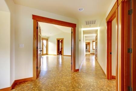 Large hallway in empty house with cork floor. New luxury home interior. Stock Photo - 18283827
