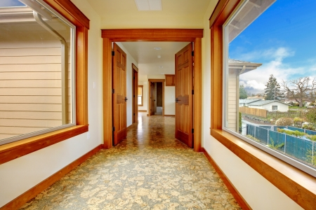 Large hallway in empty house with cork floor. New luxury home interior.