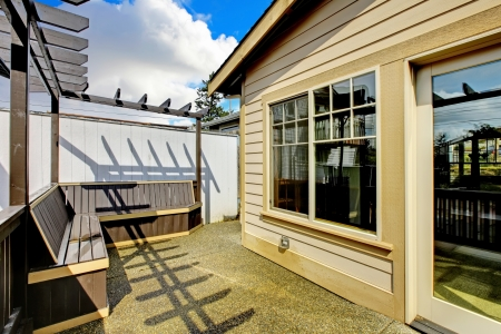 Small porch with benches in the back of the house. new luxury home exter. Stock Photo - 18283874