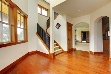 remodeled: Beautiful home entrance with wood floor. New luxury home interior. Stock Photo