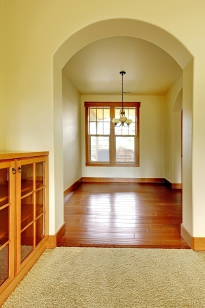 Arch doorway with empty room and wood cabinet. New luxury home interior. Stock Photo - 18283674
