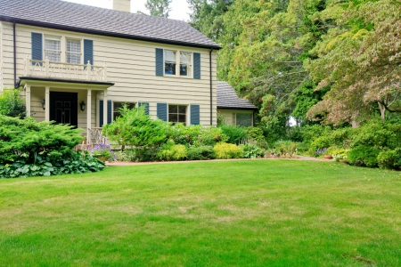 Large brown house exterior with summer garden. Northwest. Stock Photo - 18456930