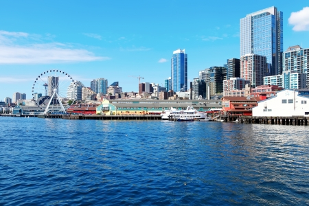 ferries: Seattle waterfront Pier 55 and 54. Downtown view from ferry.