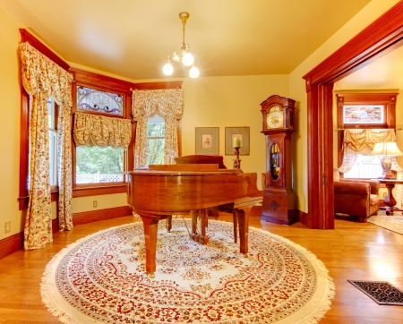 old piano: Luxury old American house living room with piano and gold colors.