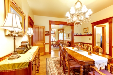 Historical American old house dining room with lots of wood and yellow walls. Stock Photo - 18457052