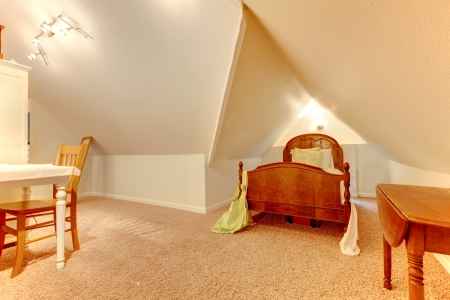 attic: Attic bedroom with desk and small bed.