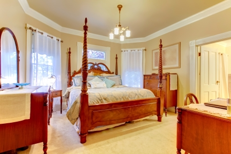 furnished: Romantic antique furnished Bedroom with dressers and large wood bed.