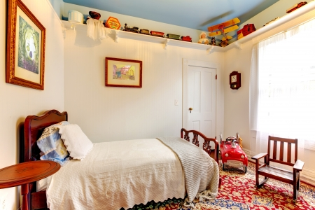 Classic antique American baby boy room with old toys.