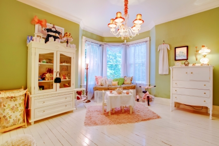Charming antique baby room with green and white colors. Stock Photo - 18457086