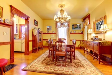 Historical American old house dining room with lots of wood and yellow walls. Stock Photo - 18457064